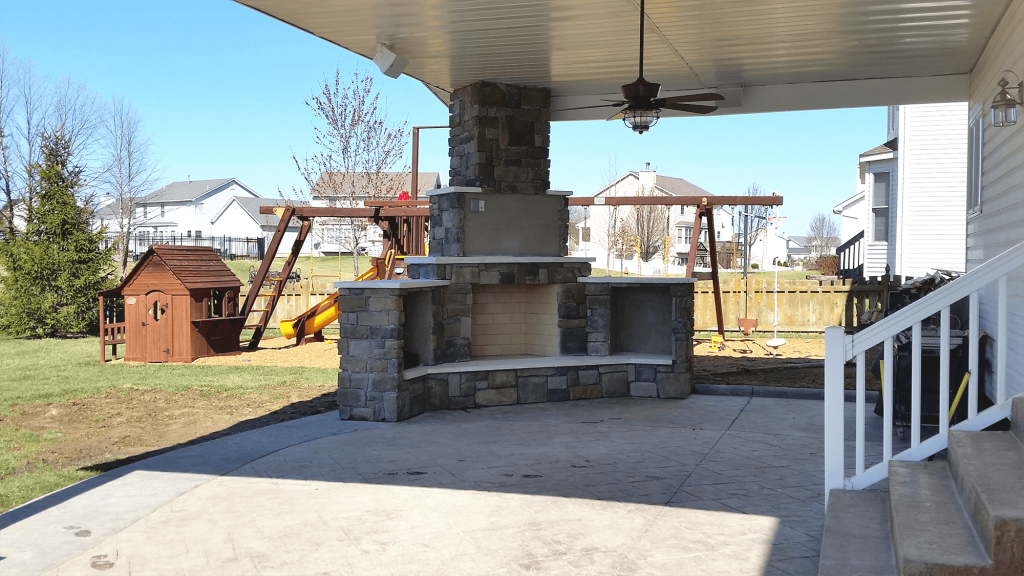 A stone oven inside a back patio.